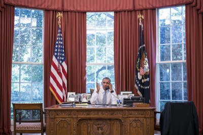 President Barack Obama talks on the phone with Cuba President Raúl Castro in the Oval Office.