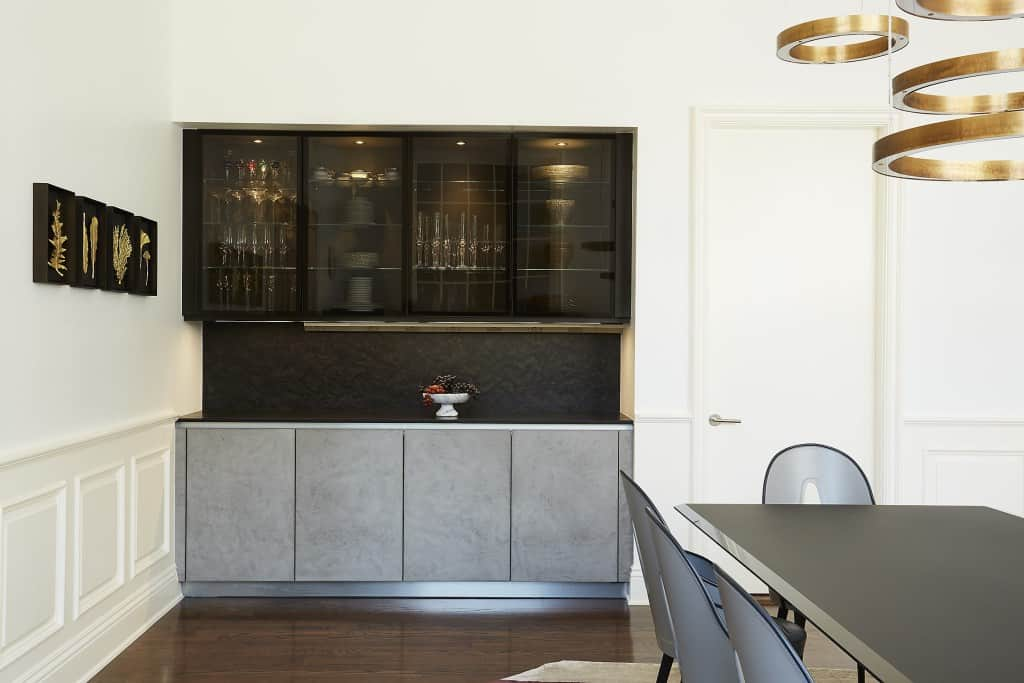 builtin buffet with smoked glass doors and stone cabinetry