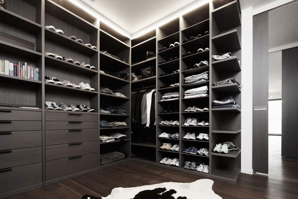 luxury walk-in closet in dark acacia by eggersmann