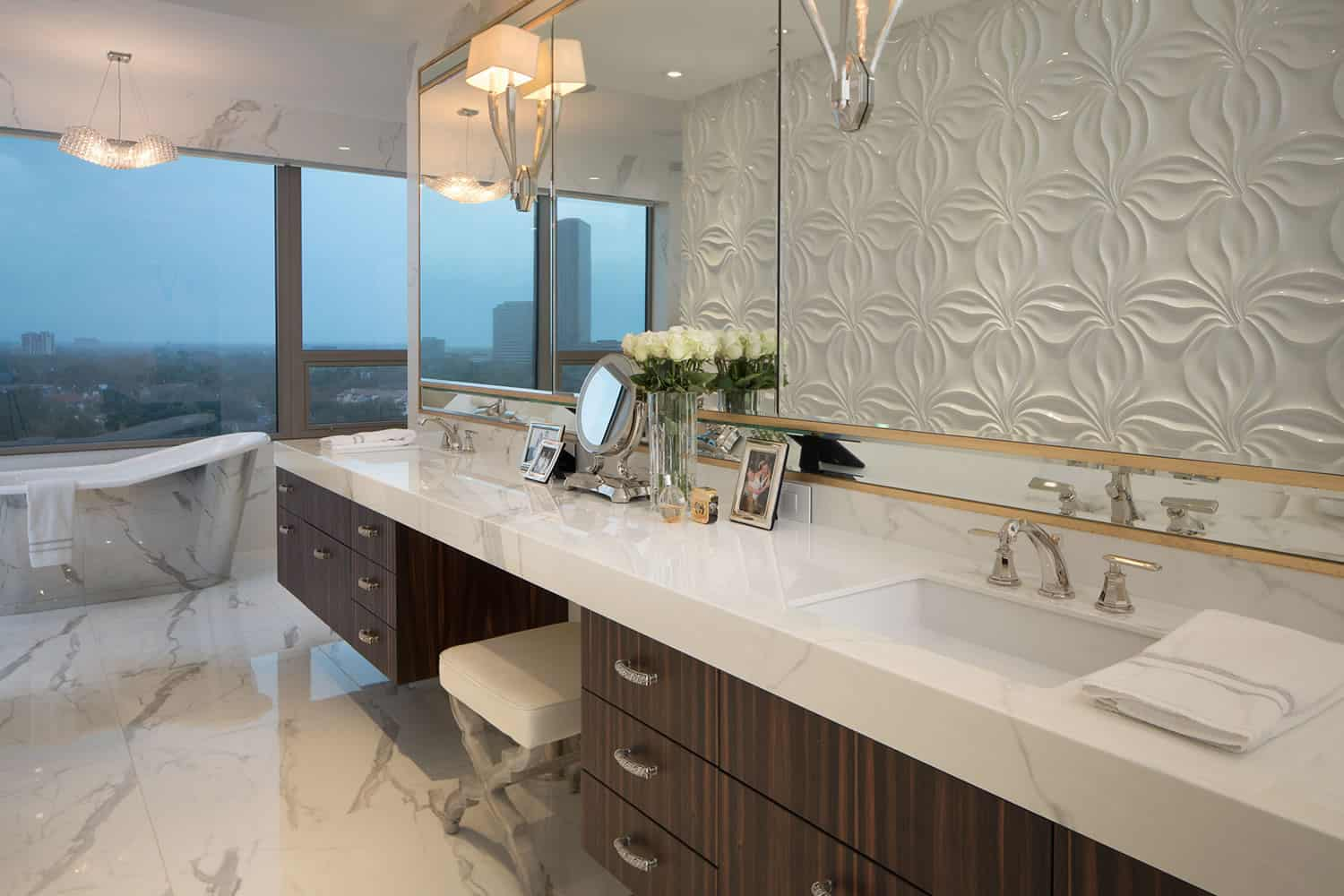expansive custom double vanity with dressing table in this highrise apartment overlooking the skyline was designed by eggersmann