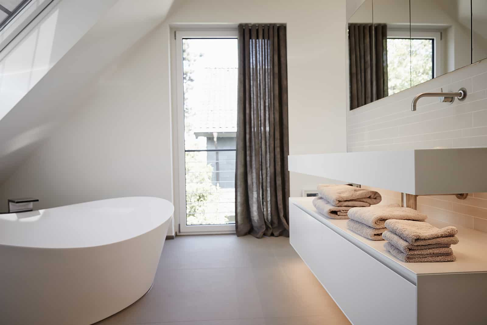 ultra modern white bathroom designed and installed by eggersmann