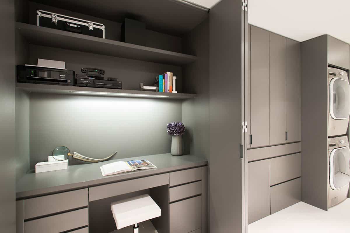 eggersmann luxury german cabinetry custom-designed for an office and laundry combination room