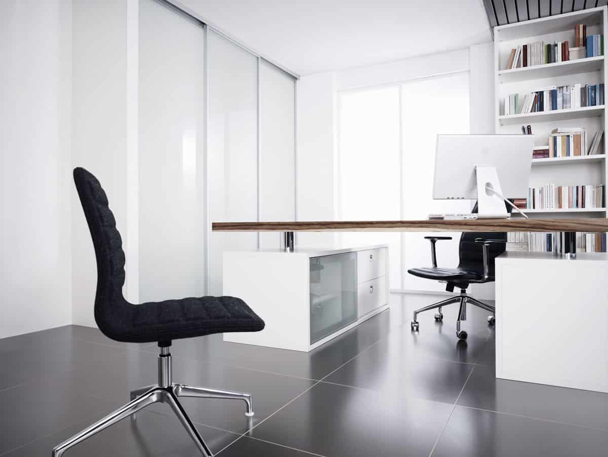eggersmann luxury german-made cabinetry in a white office with oak desktop
