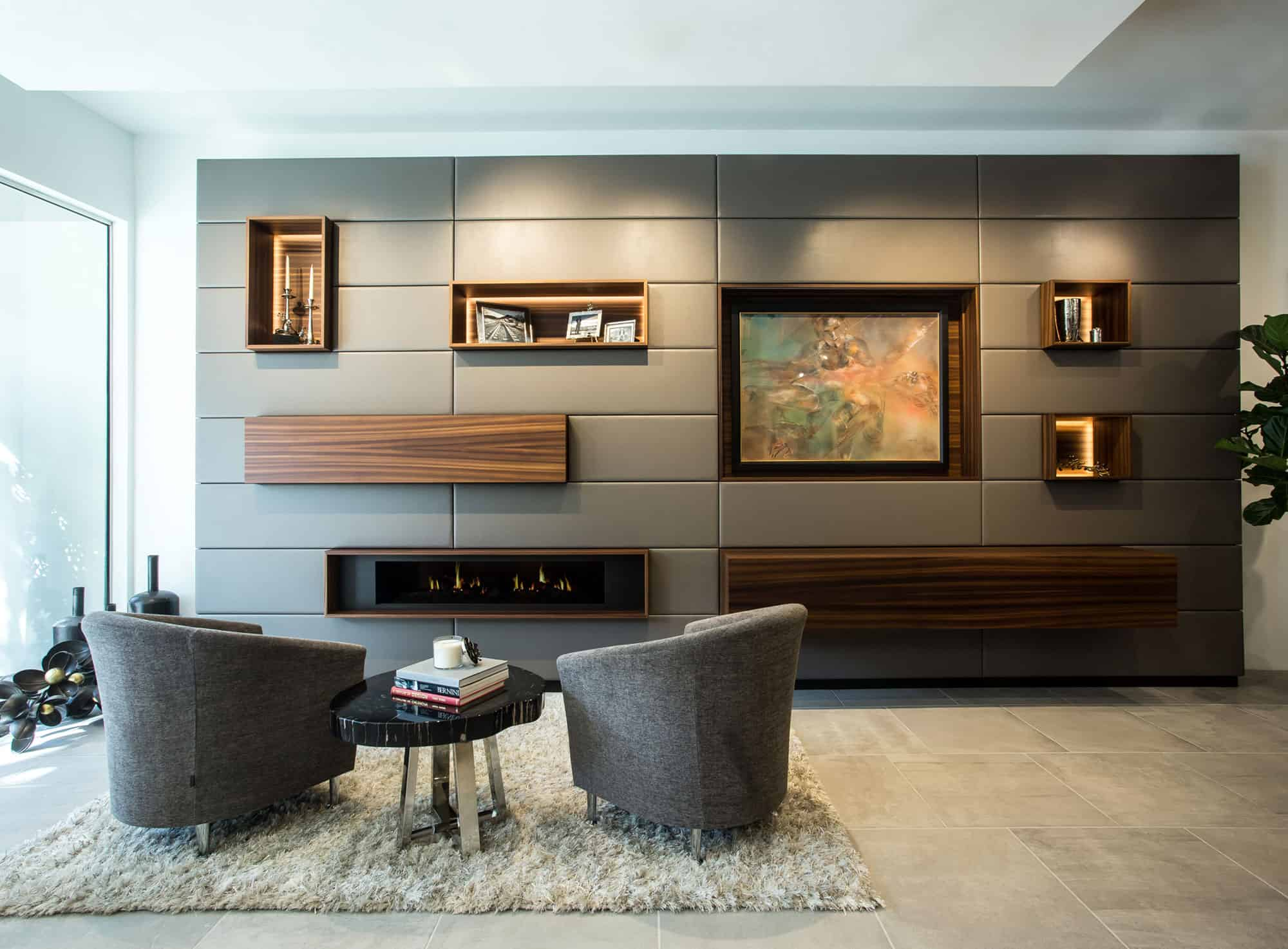 entertaining area with custom card-playing furniture and clever wall of hidden storage, bar, and electronics