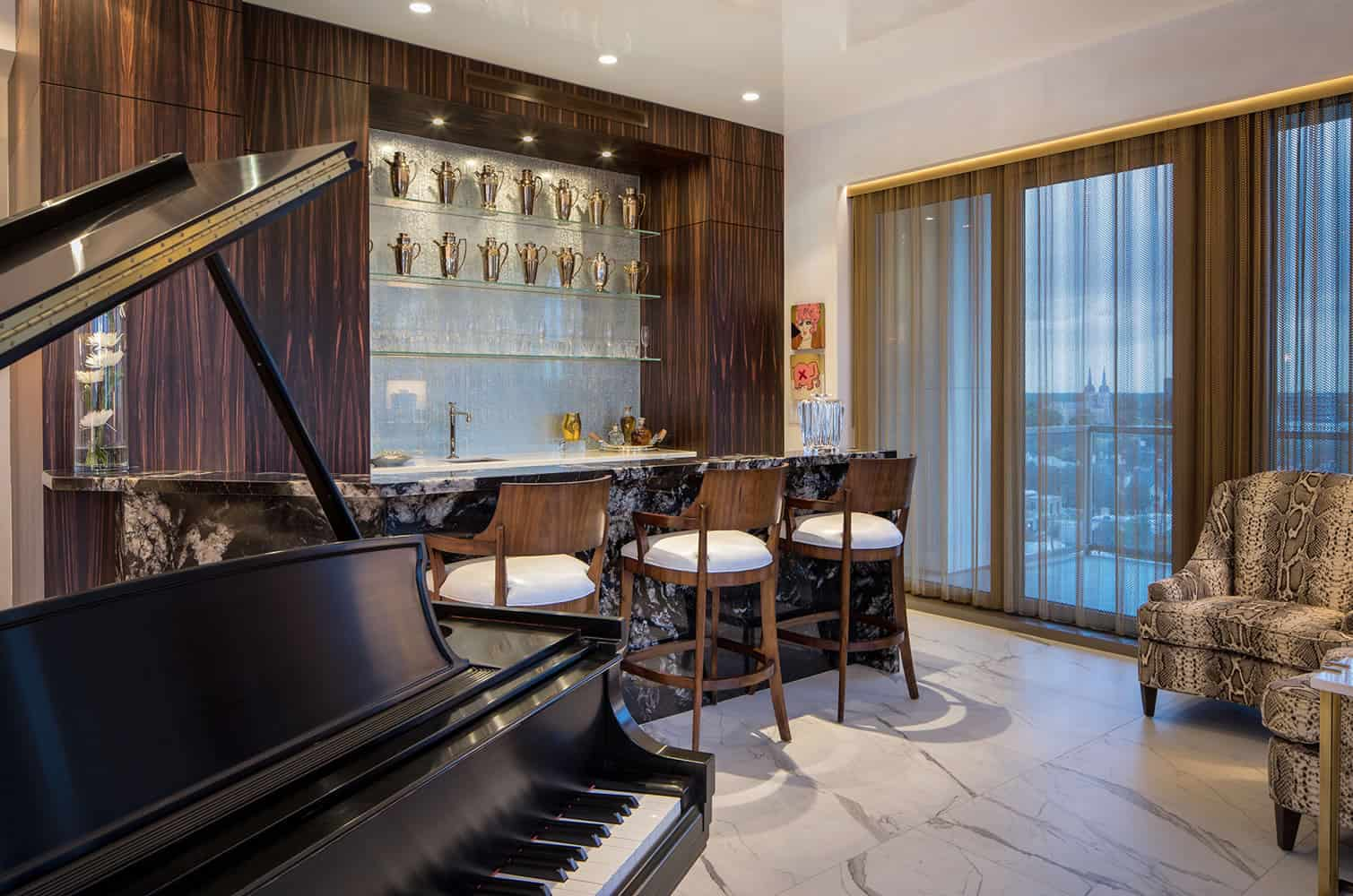 custom bar with bespoke barstools for enjoying entertainment beside the grand piano