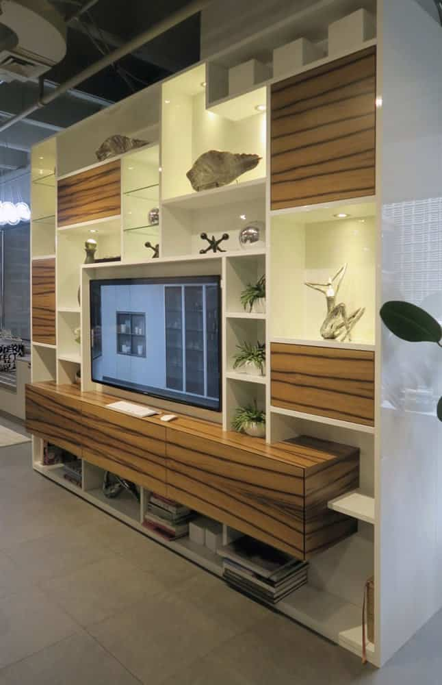 full wall of electronics, storage, and art niches designed by eggersmann