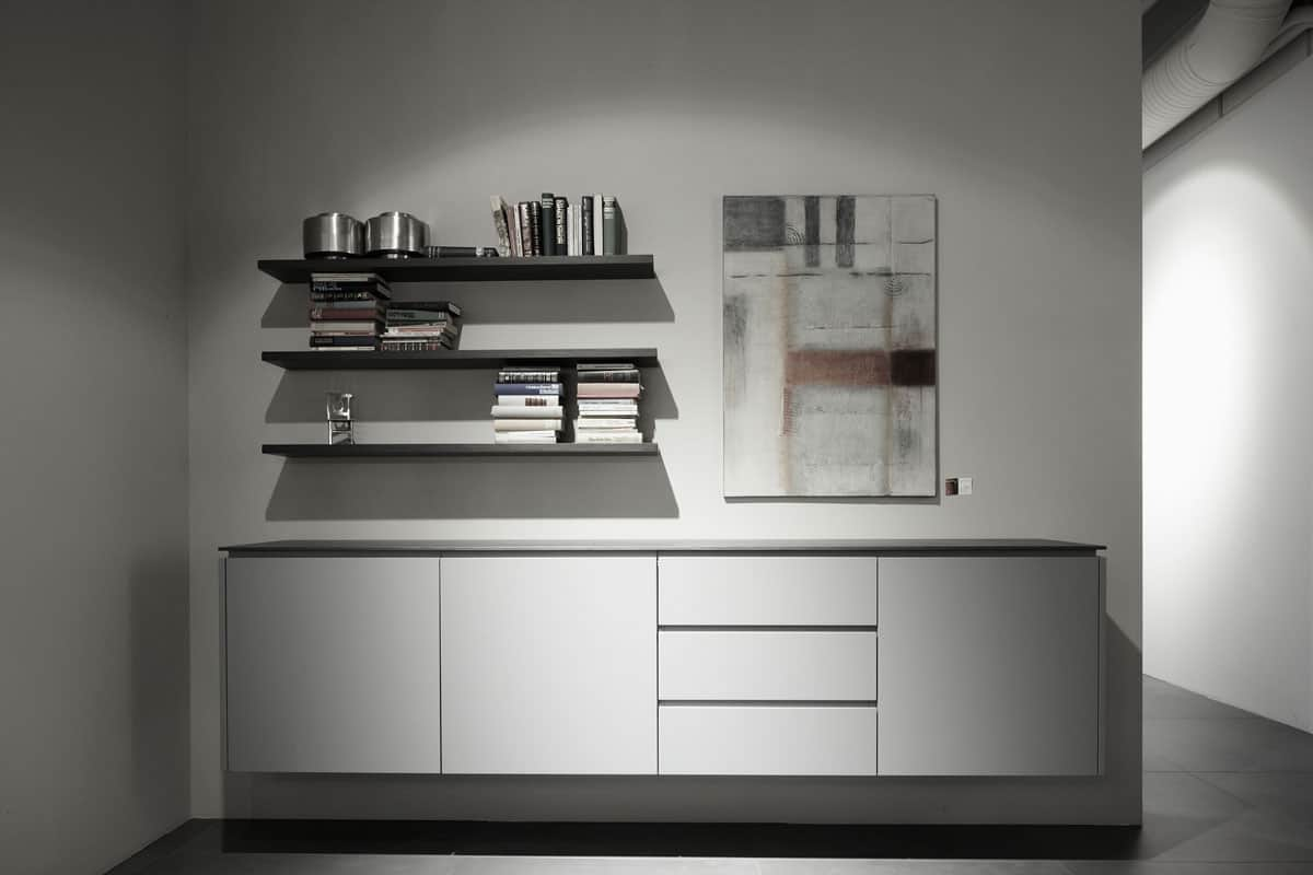well-organized craft room made clutter free with minimalist gloss white cabinetry and open shelving