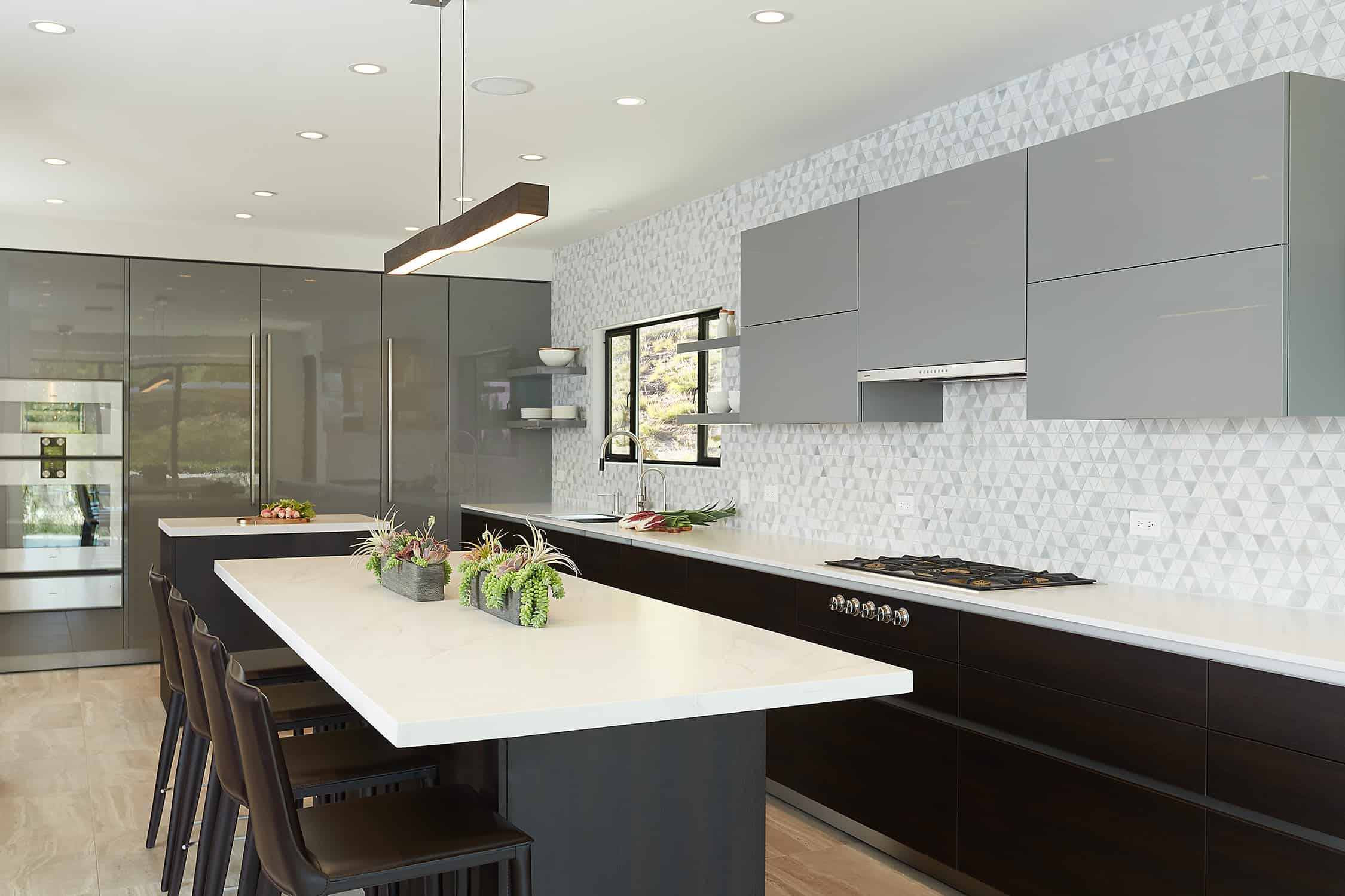 kitchen project completed by eggersmann la features a wall sleek integrated appliances and pantires
