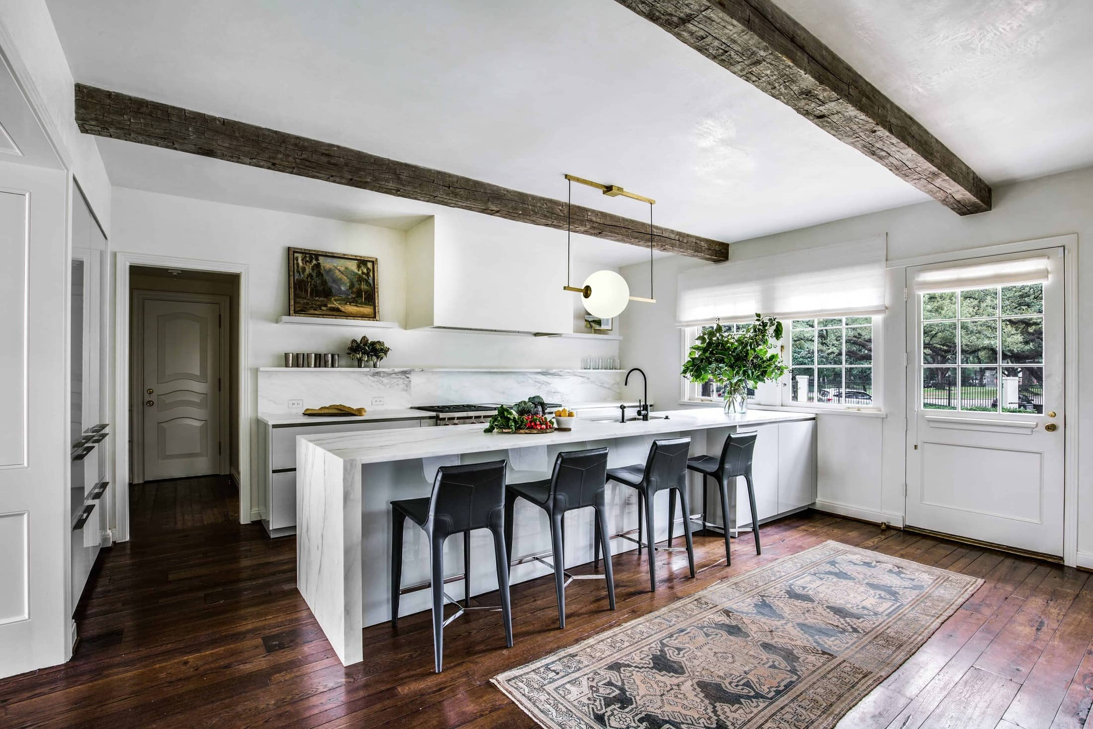 ultra-modern eggersmann german kitchen in aria stone marble featured in a parisian apartment style remodel of a home in the Houston Museum district