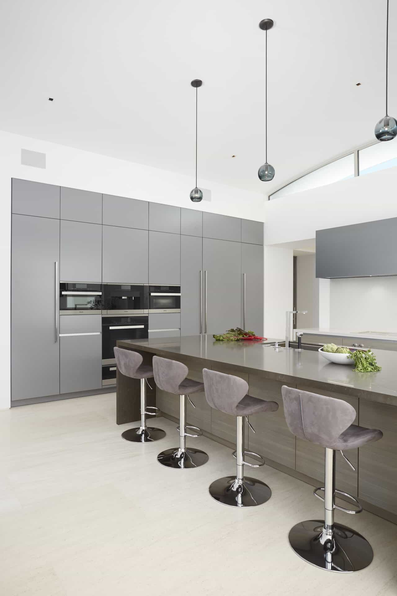 Main kitchen's in Pine Grey Decor and Custom Matt lacquer with breakfast bar and Miele appliances