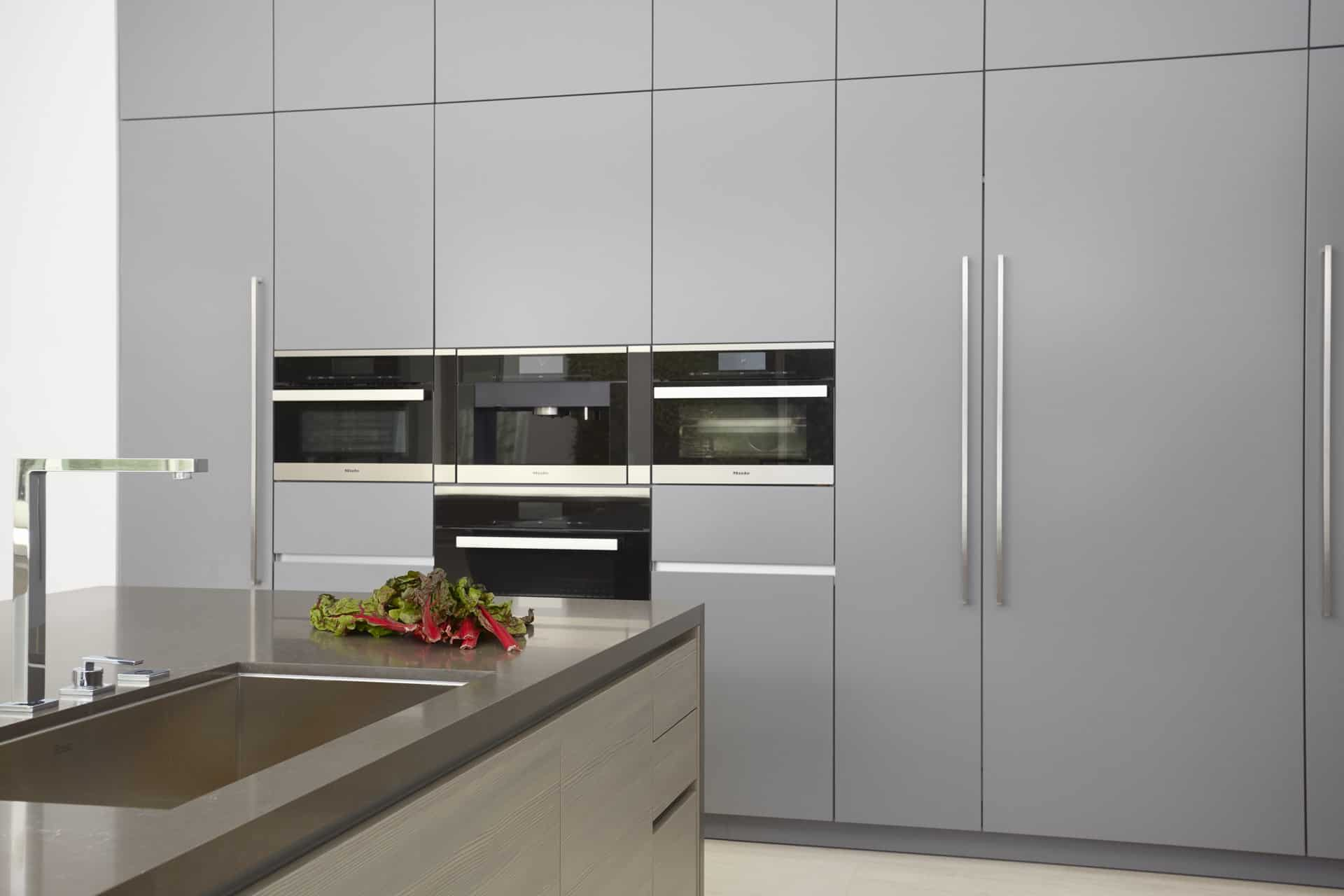Main kitchen's luxury Miele kitchen appliances and integrated refrigerator freezer