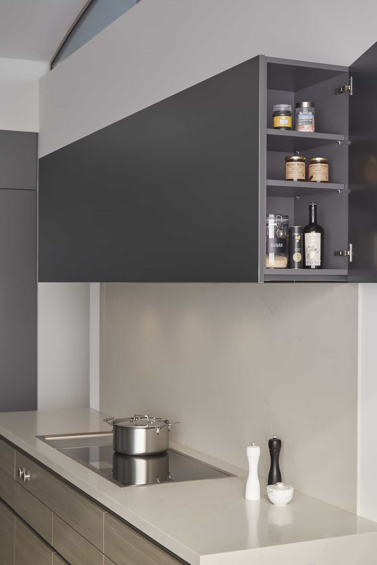 A surprise endcap cabinet in the main kitchen flanking the stove hood with Miele insert