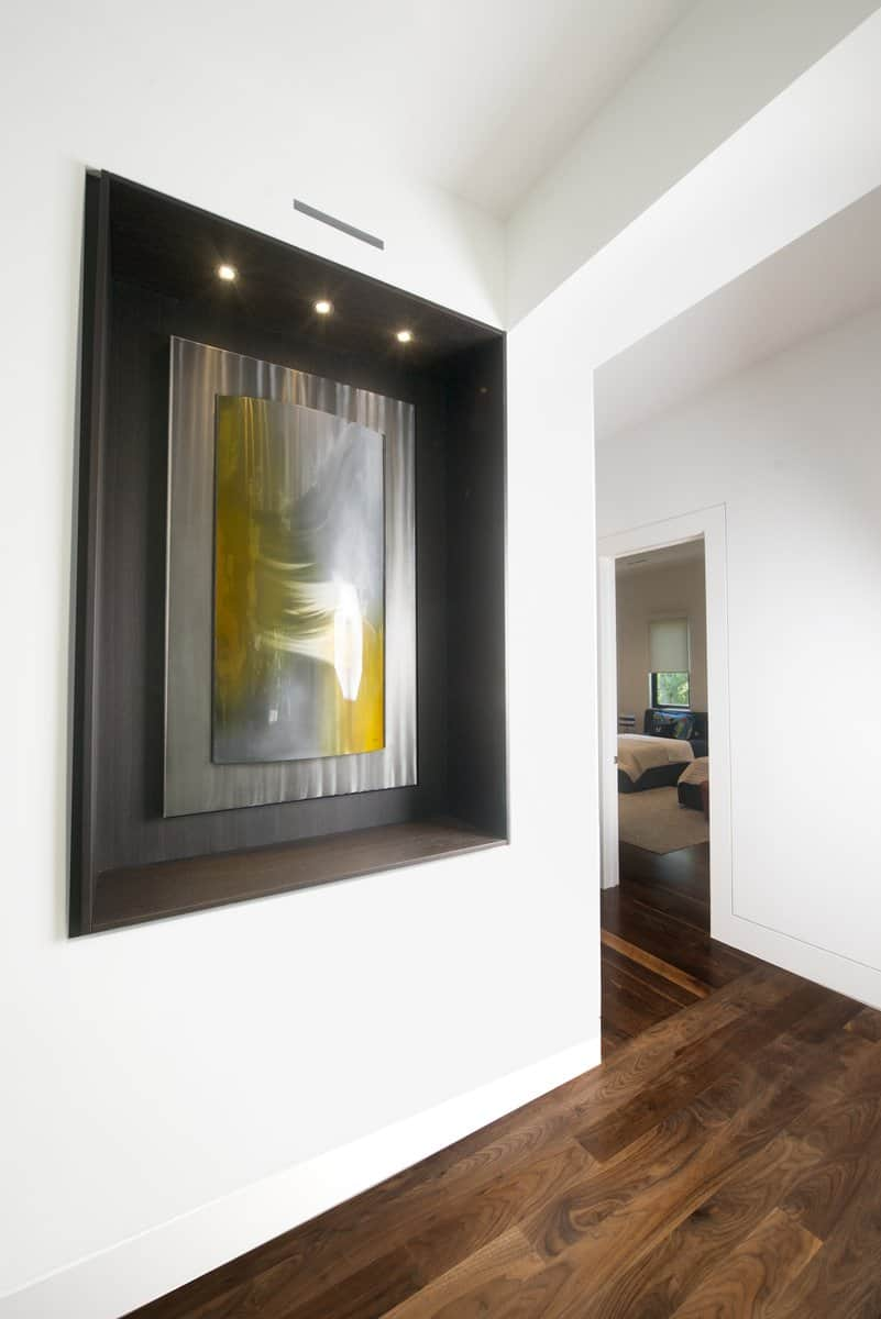 lighted art niche designed by eggersmann sets off the homeowners' art collection