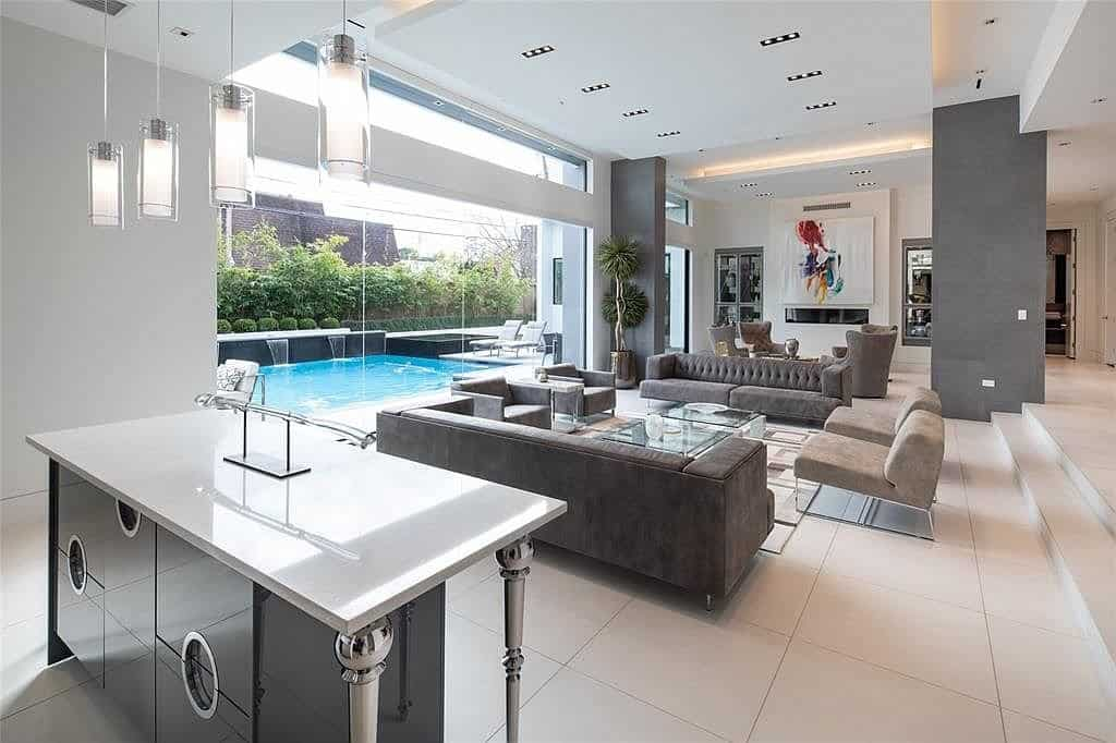 living area and bar off outdoor pool
