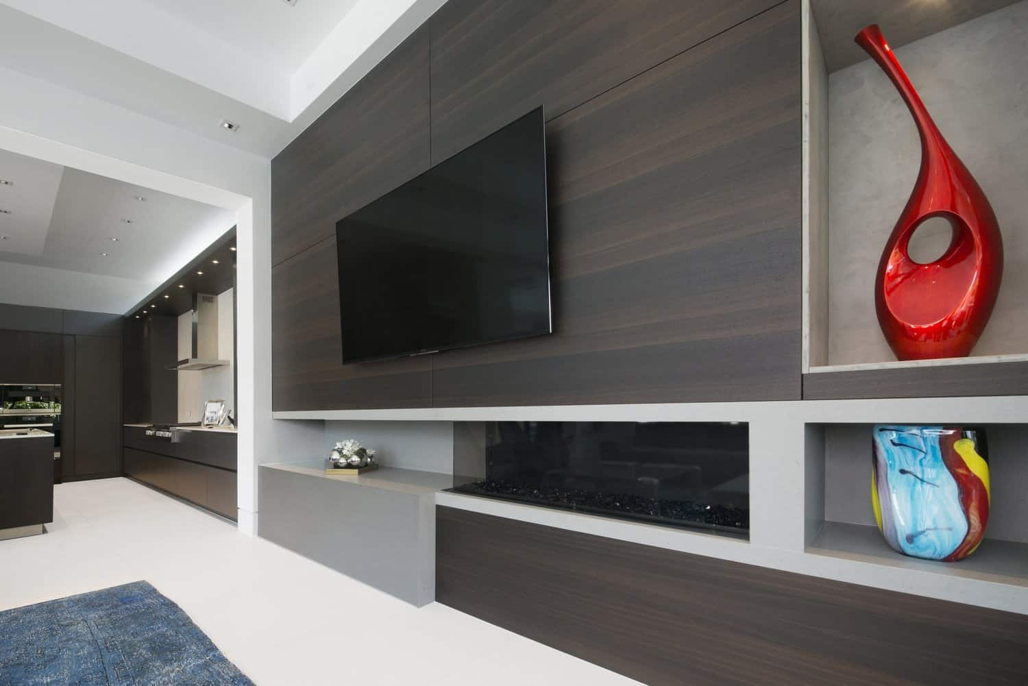 media room with eggersmann designed fireplace surround and display niches
