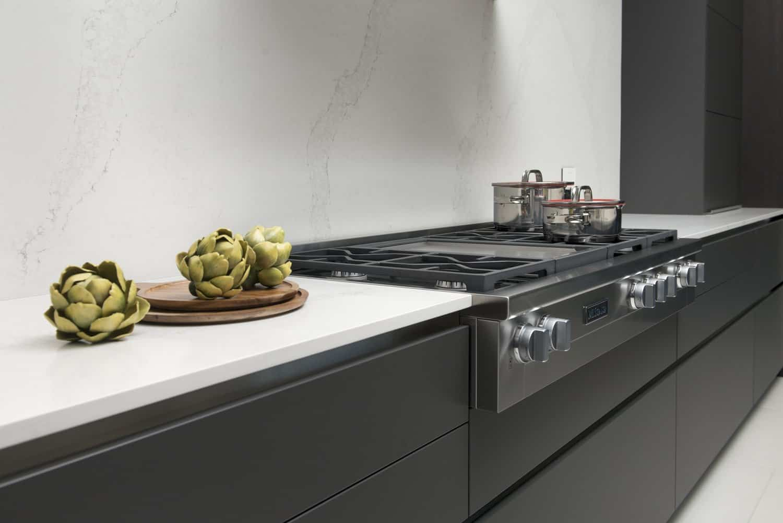 miele stovetop in caesarstone quartz countertop with matching backsplash