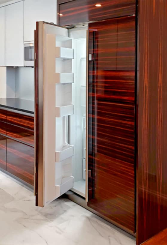 subzero fridge freezer combo integrated into maccassar ebony cabinetry with high gloss lacquer finish