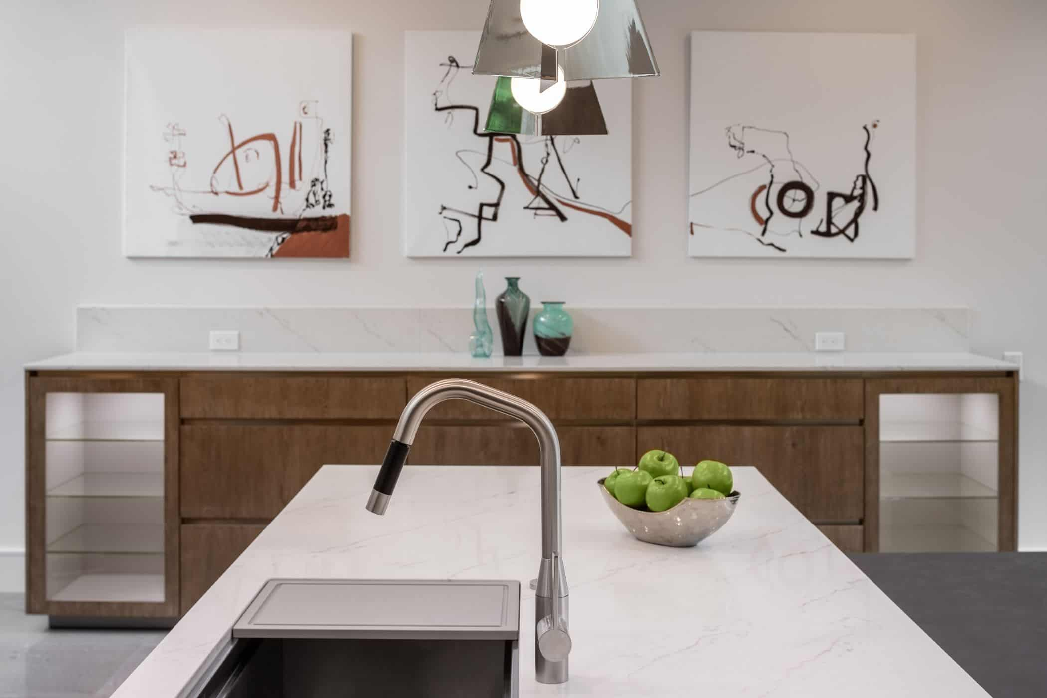 contrasting wood veneers and near-white countertops in a washington coalition memorial park area home in houston