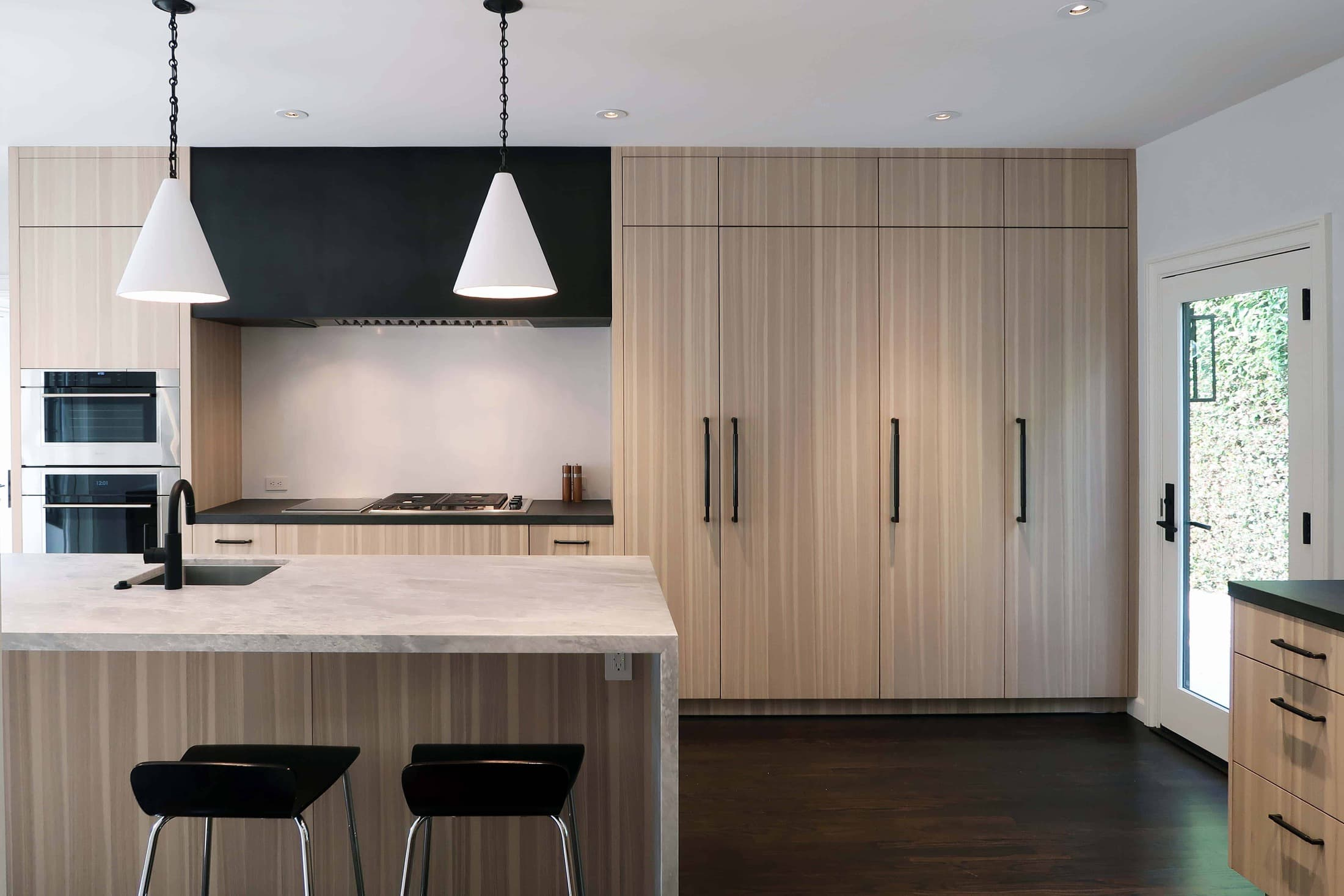 after picture of storage and layout of a modern eggersmann kitchen with traditional touches created in a hancock park traditional home in los angeles