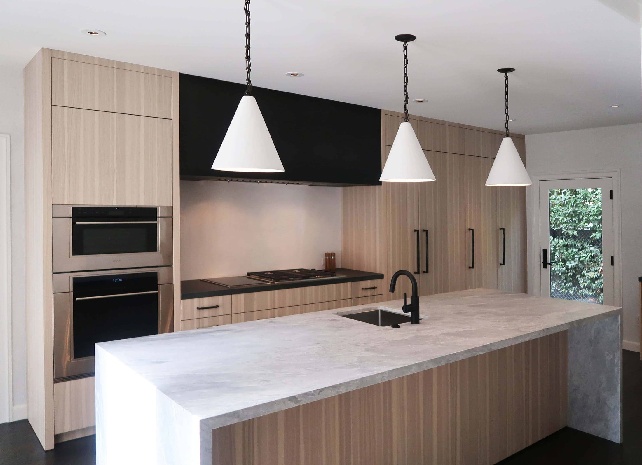 after picture of a modern eggersmann kitchen with traditional touches created in a hancock park traditional home in los angeles