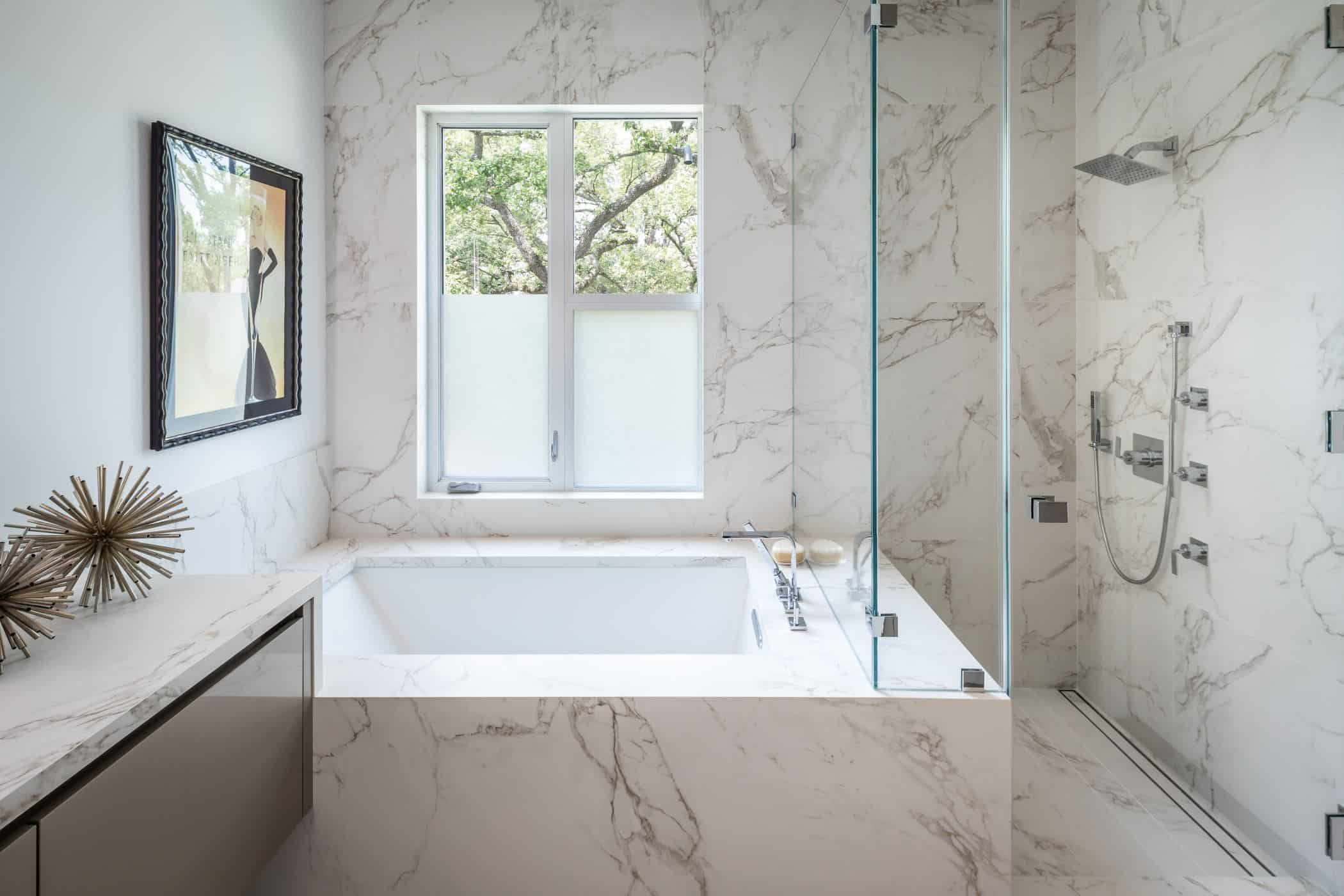 shower tub combo of a master bathroom fitted by eggersmann in a houston new construction home