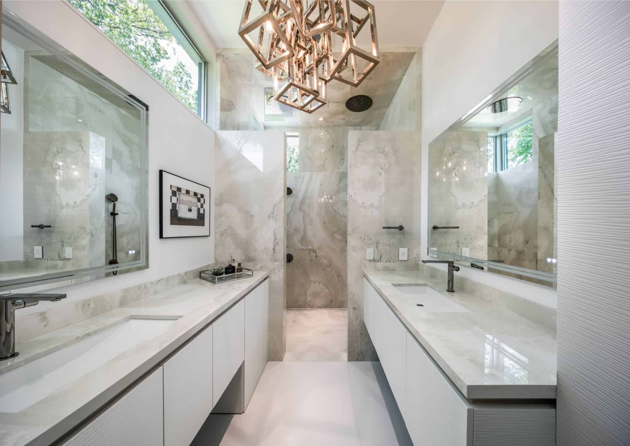 master bathroom fitted by eggersmann in a houston new construction home features trough sinks