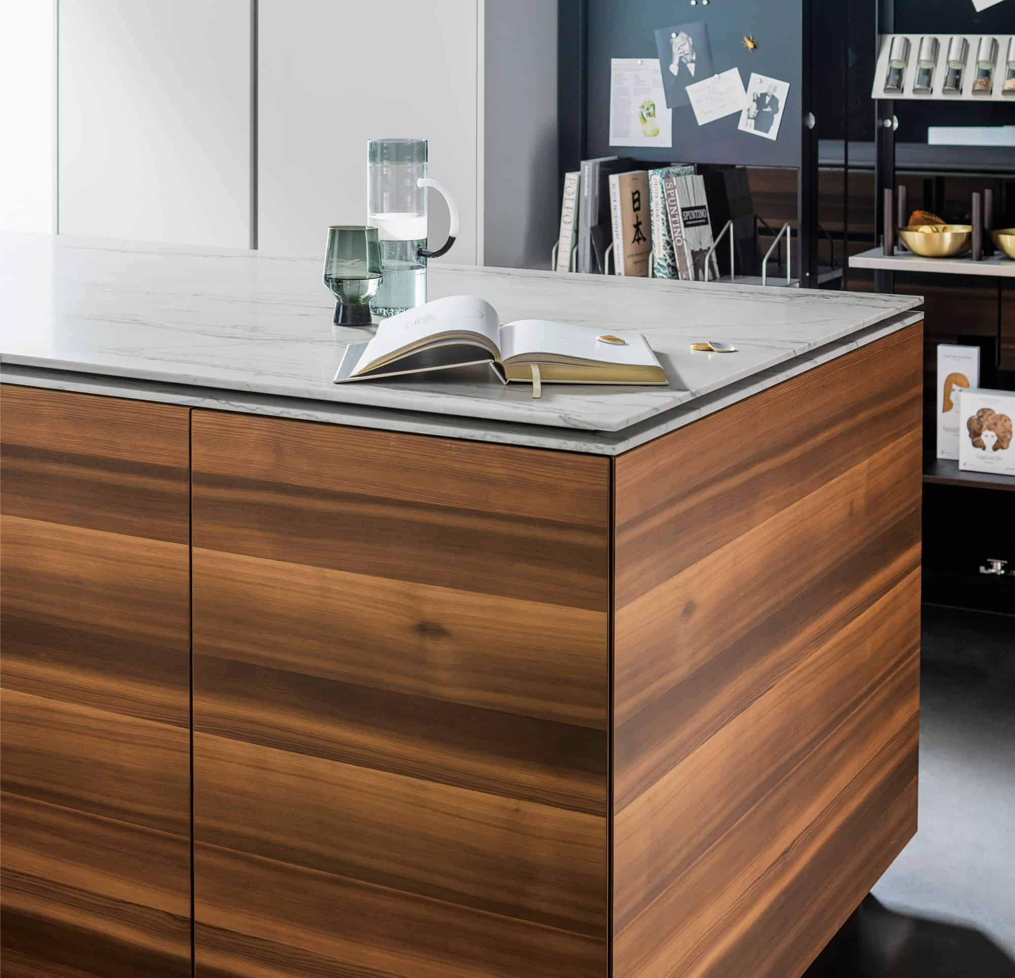 eggersmann MOTION sliding countertop when closed hides an induction cooktop and stows away a breakfast table