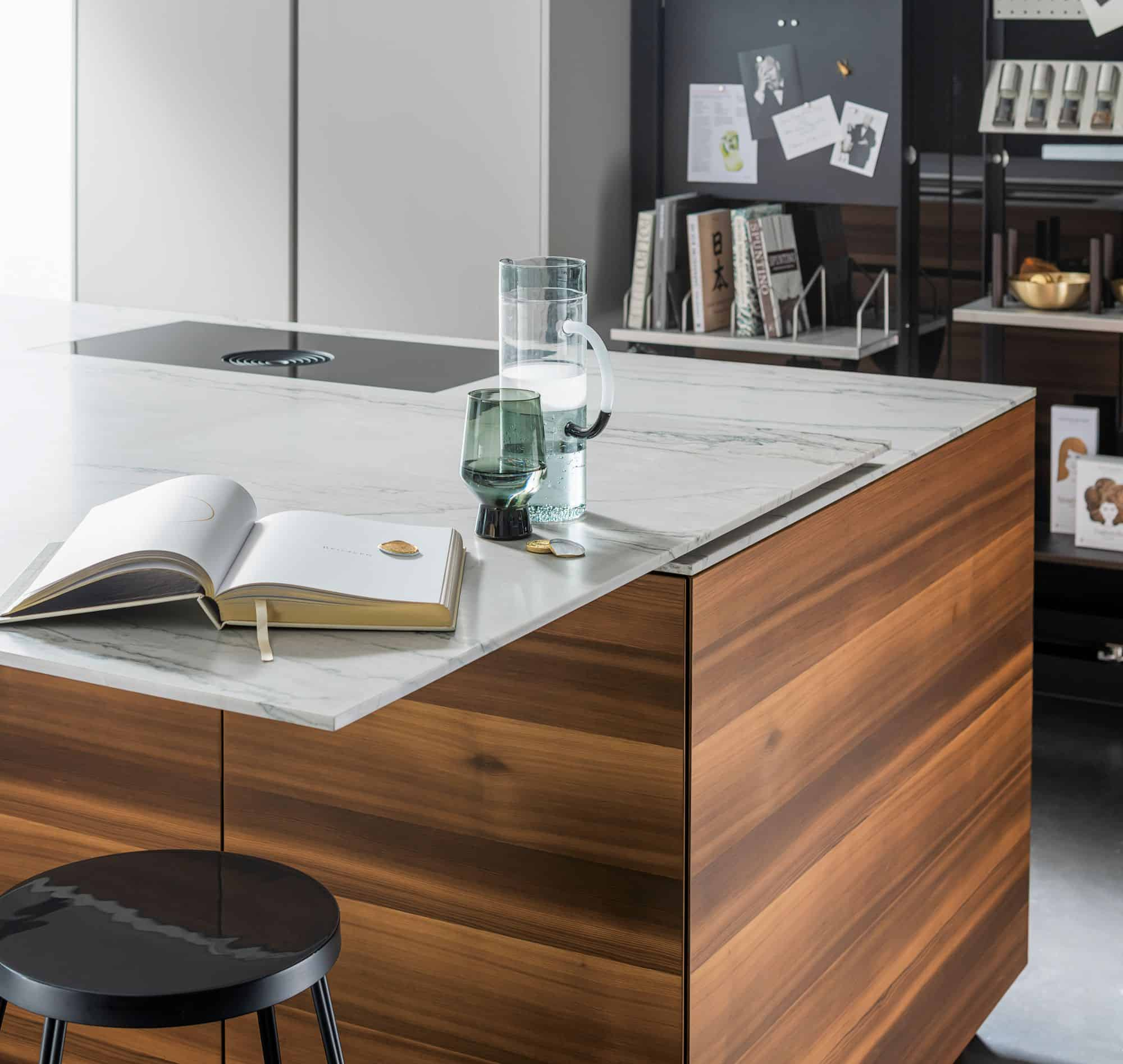 eggersmann MOTION sliding countertop opens to reveal induction cooktop simultaneously creating a dining table