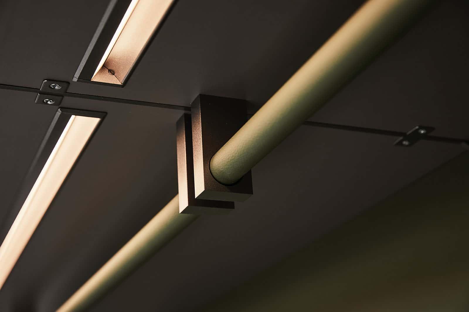high quality hanging rails in a custom luxury walk-in closet