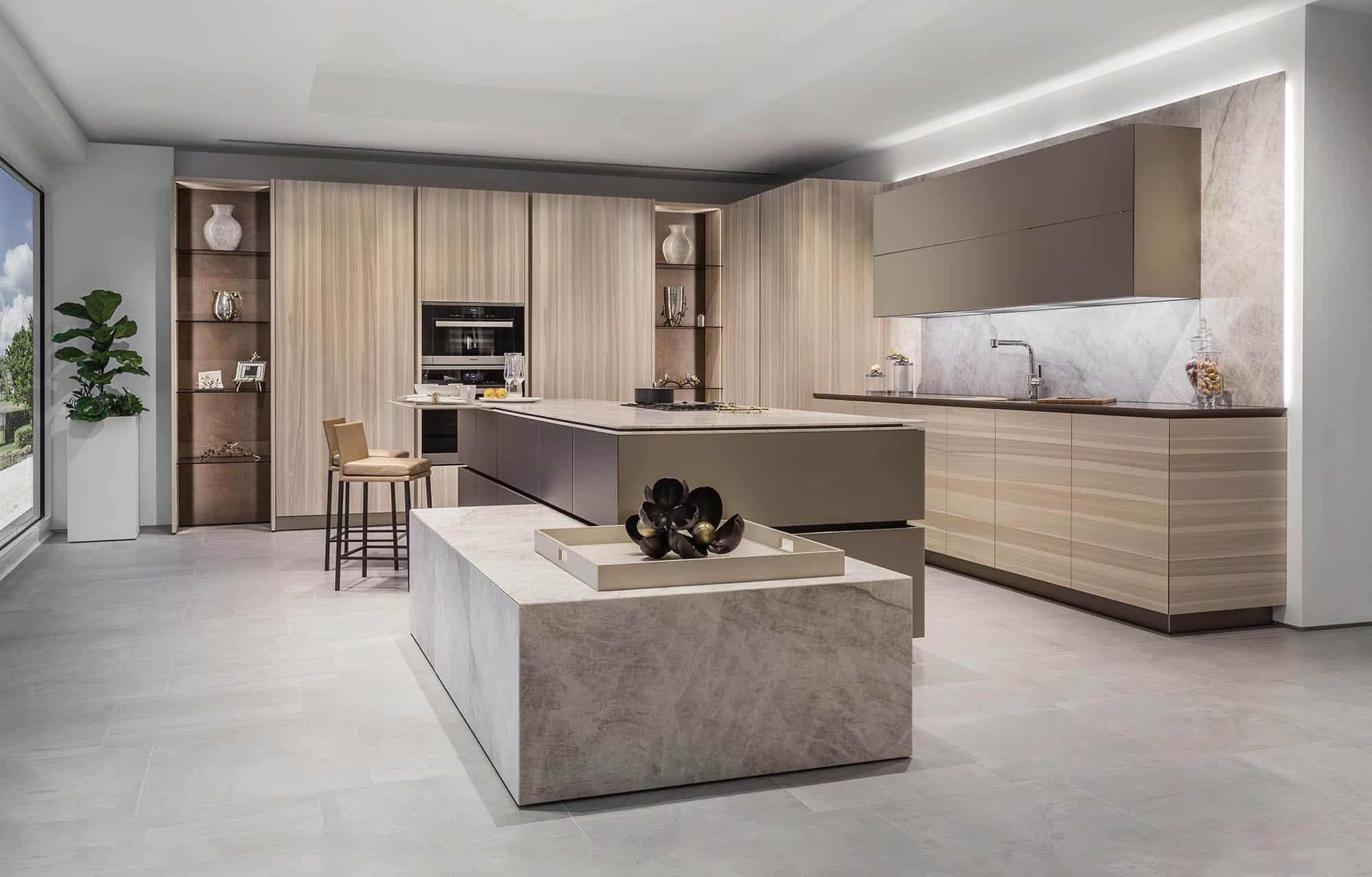 frameless and handleless unique cabinetry by eggersmann in a kitchen featuring exotic wood finishes and integrated appliances