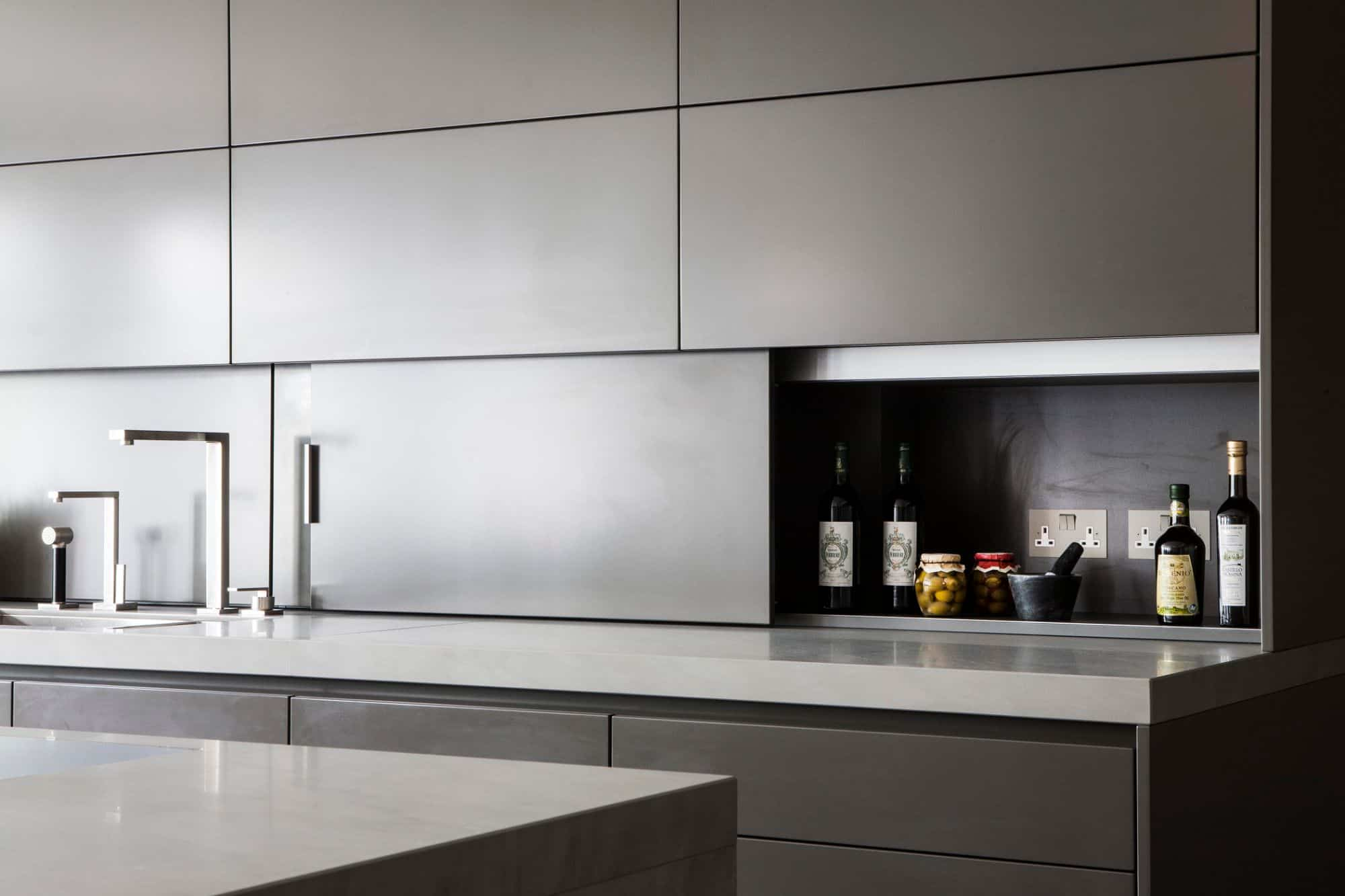 hidden backsplash storage to reduce clutter