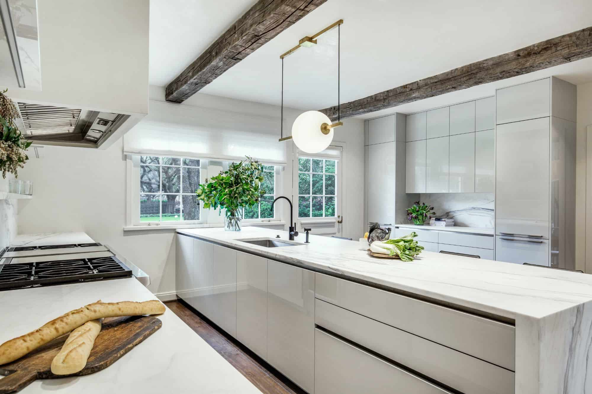 Green plants like these in this luxury stone kitchen add a natural feel that boosts your creativity