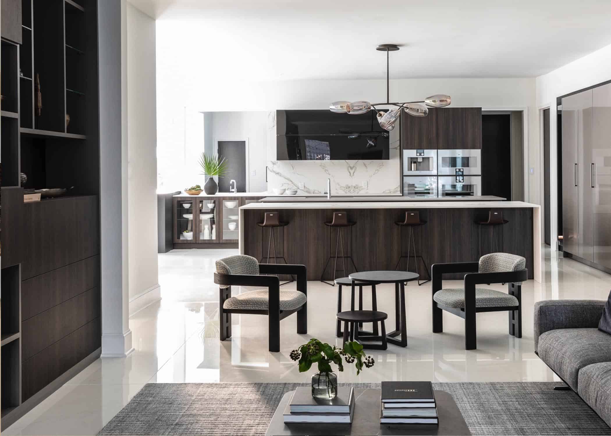 dark woods and light marble with both modern and traditional accents create the perfect kitchen for entertaining and daily living