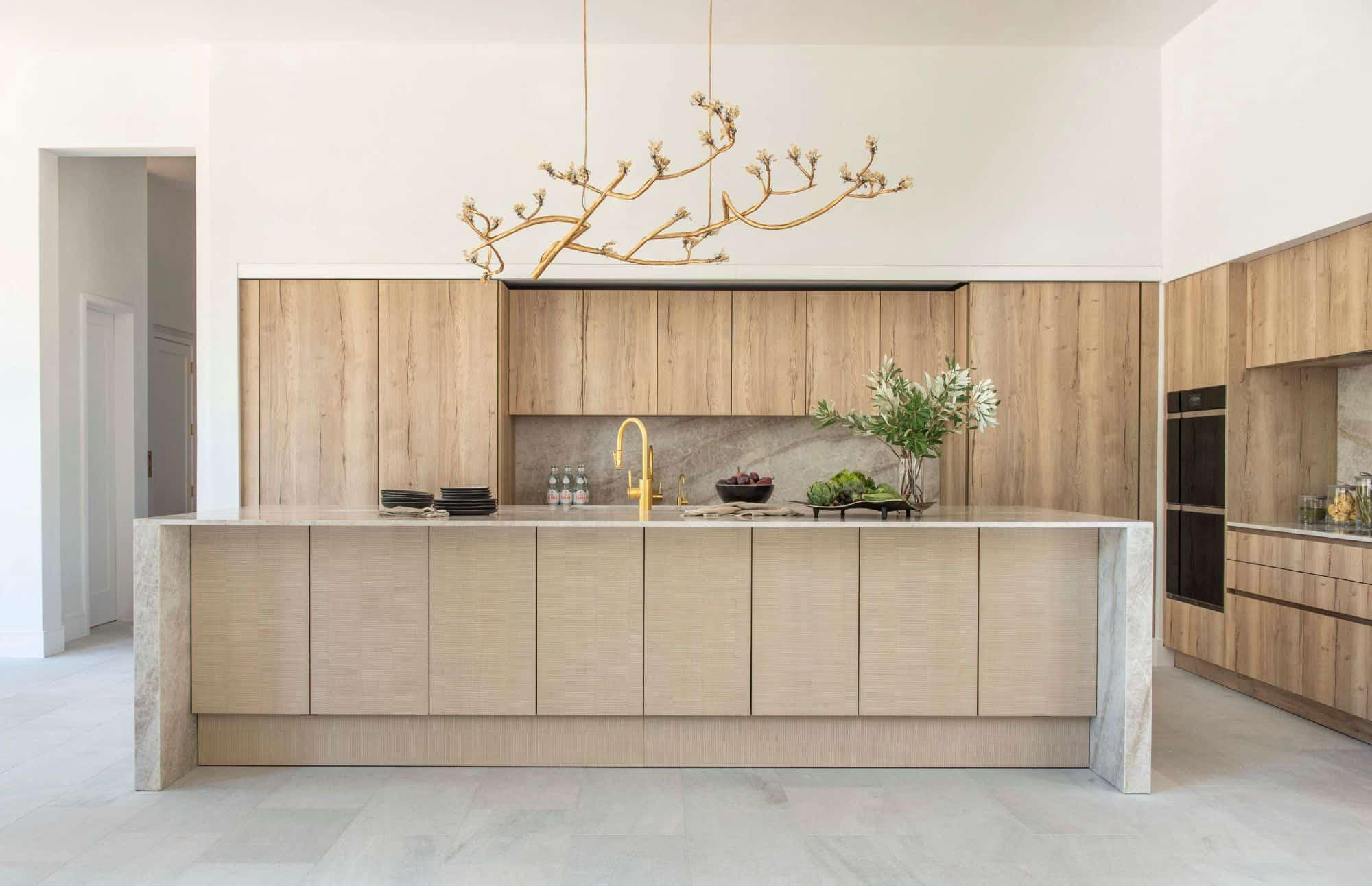 woodsy yet modern kitchen in light wood tones and marble by eggersmann