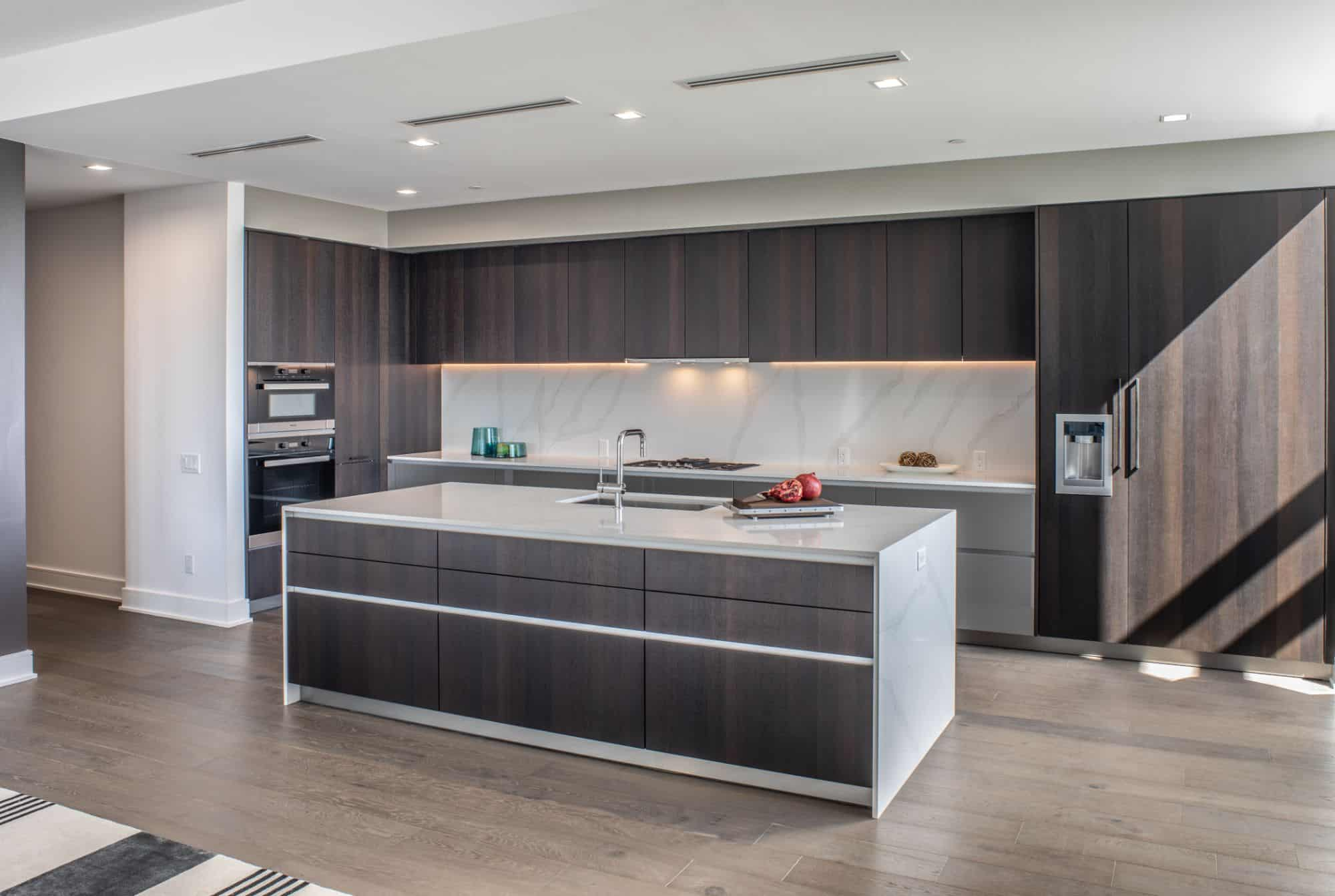 dark woods and light marble make a dynamic kitchen by eggersmann