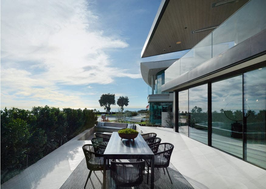 expansive balcony of a beachfront modern mansion in corona del mar in newport beach californai