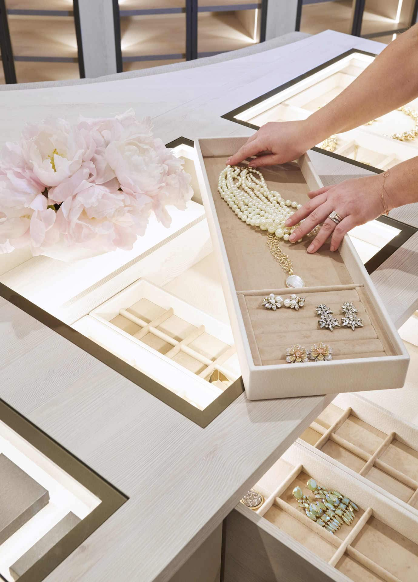 custom drawers and organizers make access to dressing accessories quick and easy