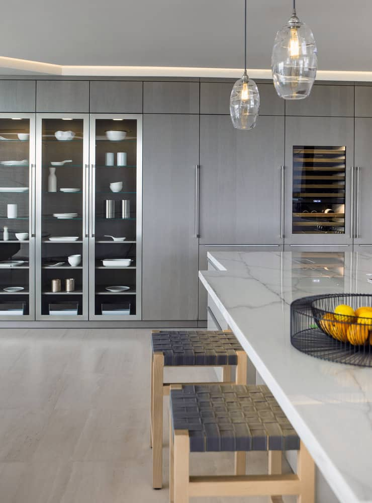 custom wall storage in a corona del mar home's luxury contemporary kitchen