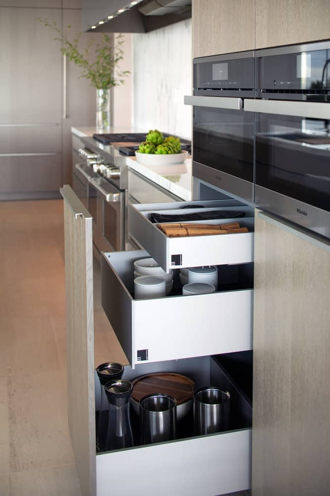 custom storage in corona del mar home's luxury modern kitchen