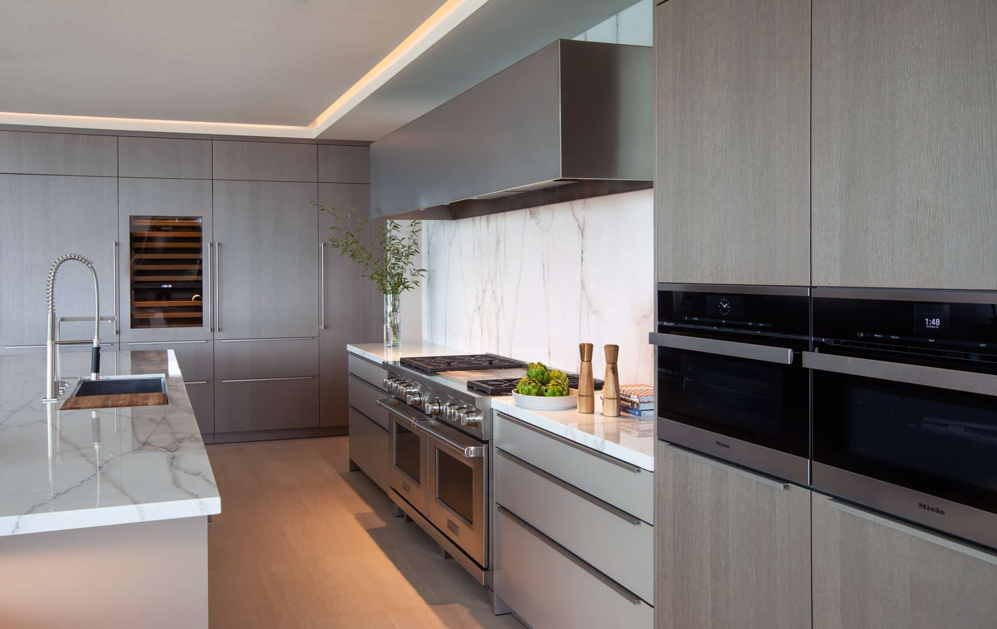 high-end appliances and natural finishes in a corona del mar home's luxury contemporary kitchen