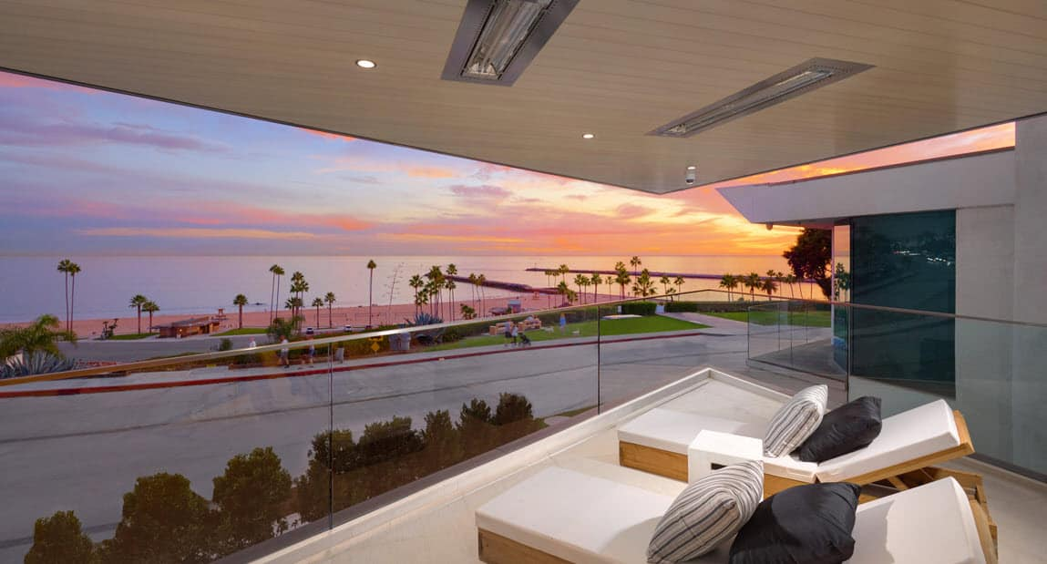 sunset from the terrace of a luxury beachfront home in newport news, california