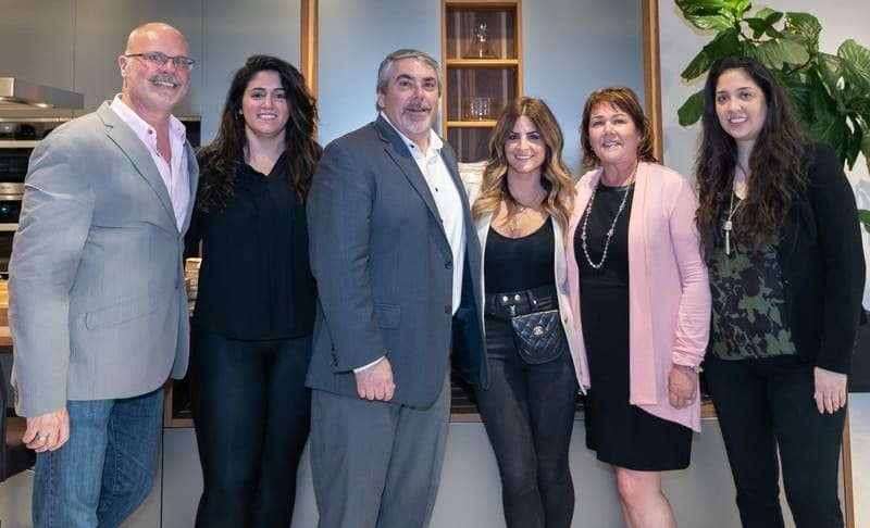alison victoria with eggersmann usa owners, michael and sandra soltoff, and design staff