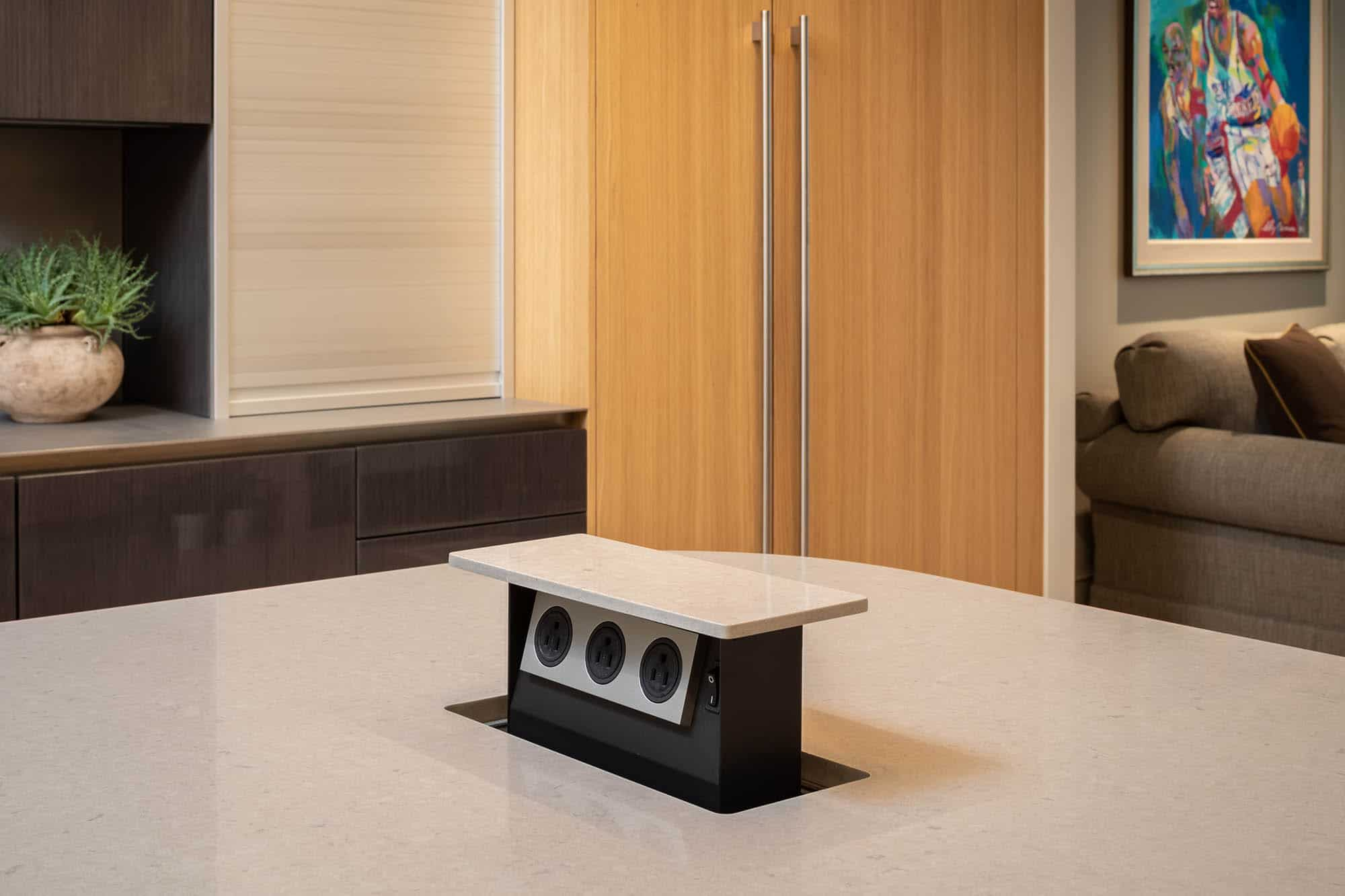 hidden outlets in solid surface countertop are convenient when opened