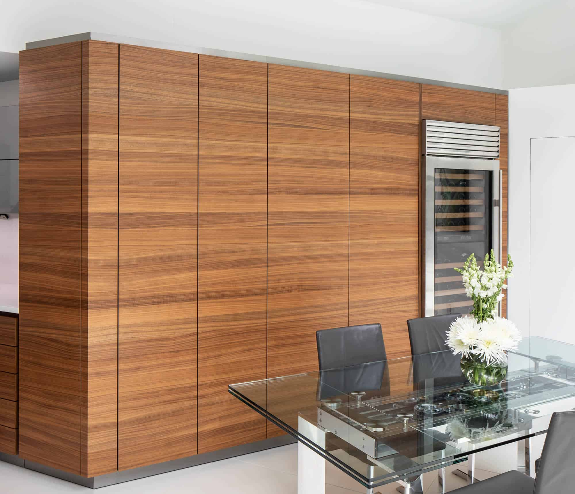 pocket doors conceal a bar and coffee bar with storage