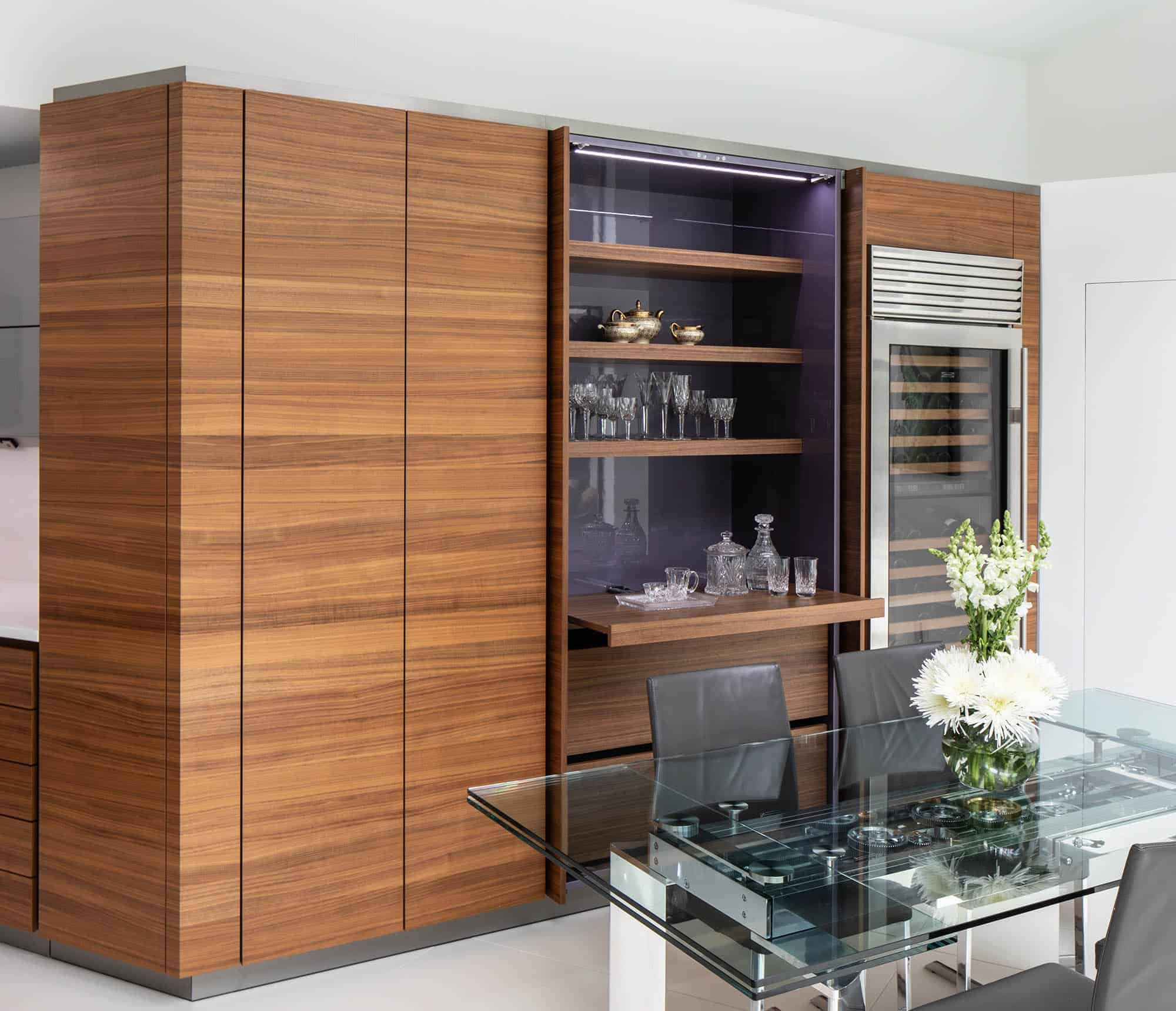 pocket doors when open reveal a bar and coffee bar with storage