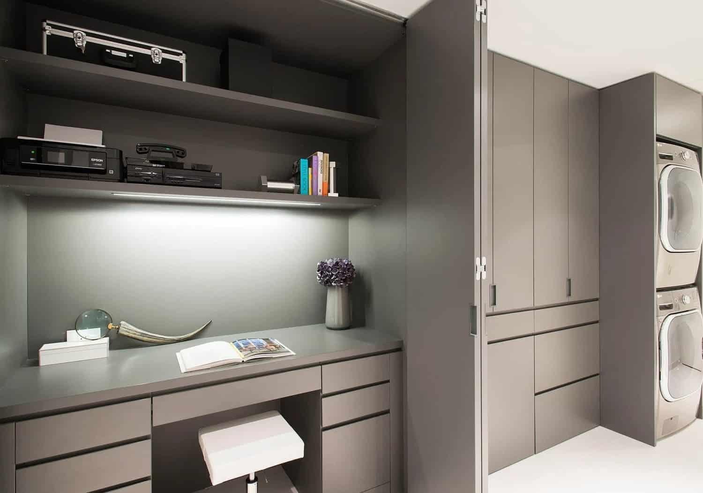 bi-fold doors concel a kitchen desk area