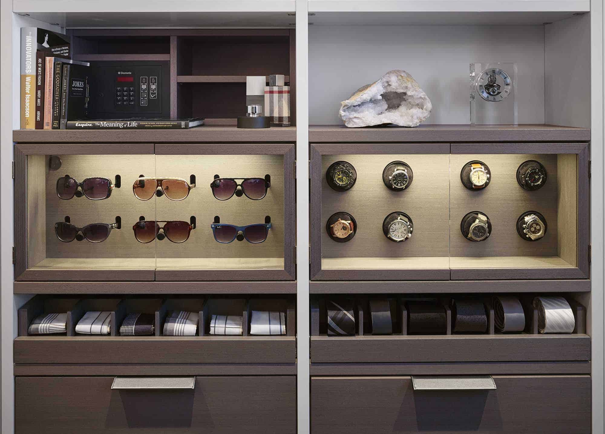 hidden safe revealed in a luxury custom closet