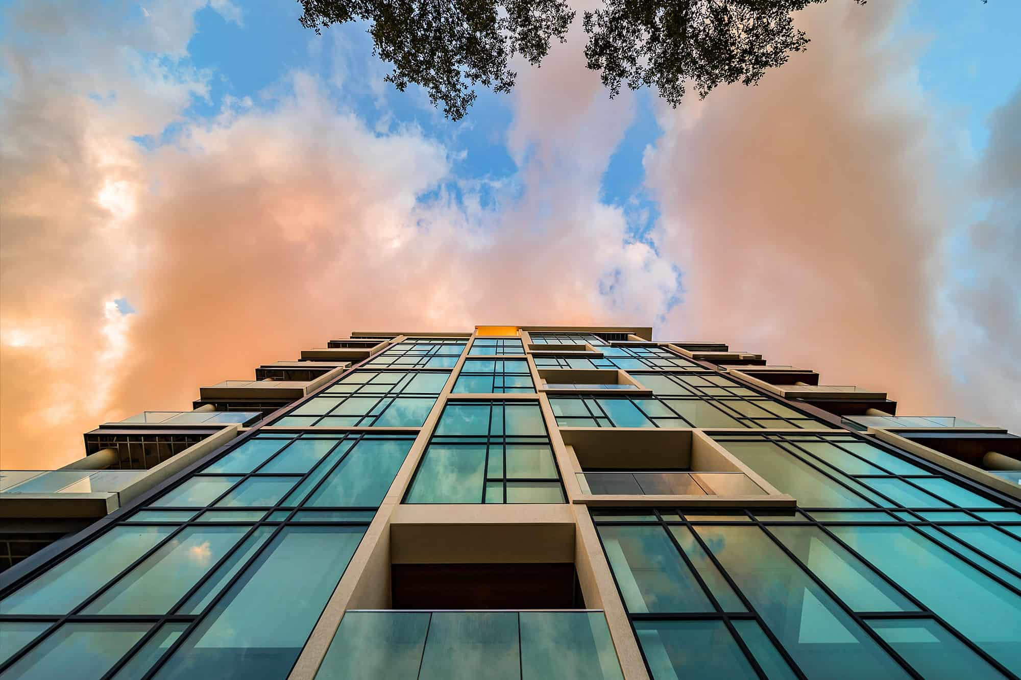 mondrian luxury apartments facade from the ground looking up to the sky
