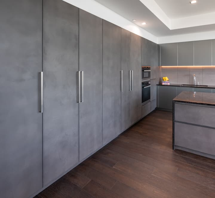 integrated luxury appliances on a tall german cabinet wall in unit 601 kitchen at the mond luxury condos