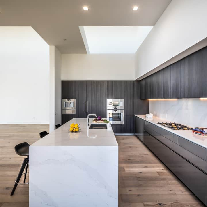 kitchen with high-end gaggenau appliances in the penthouse condo unit 801 of the mond at the museums